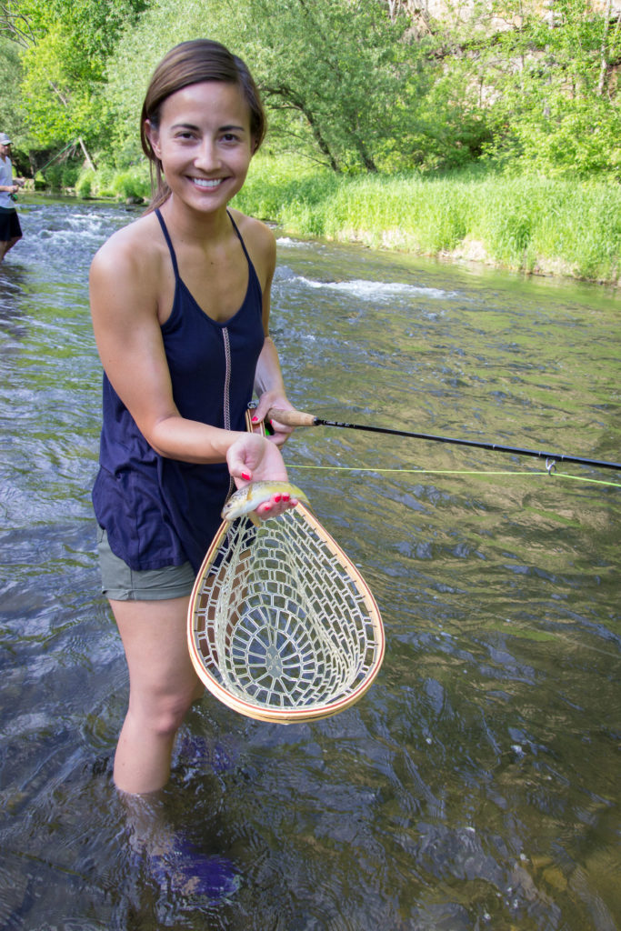 Angy's first fish on a fly.